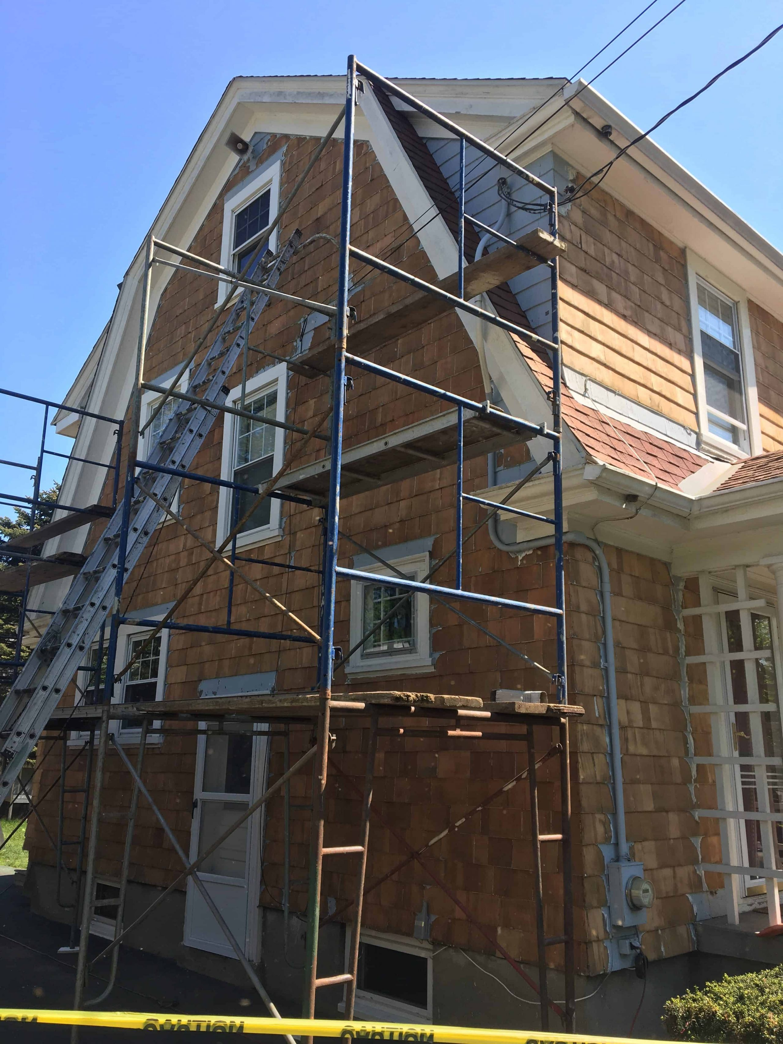 stripping off paint from cedar shingle surface